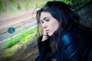 girl thinking railroad kyle-broad-29486-unsplash