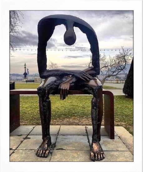 statue grieving parents